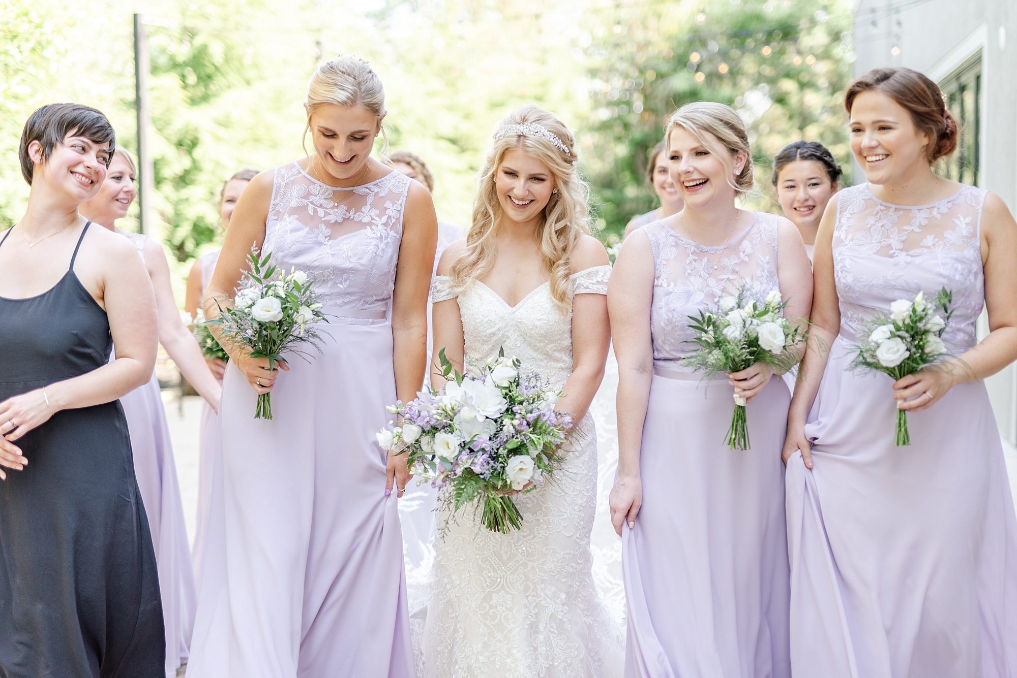 bride laughs with bridesmaids in lilac gowns at Brookshire in Columbus OH