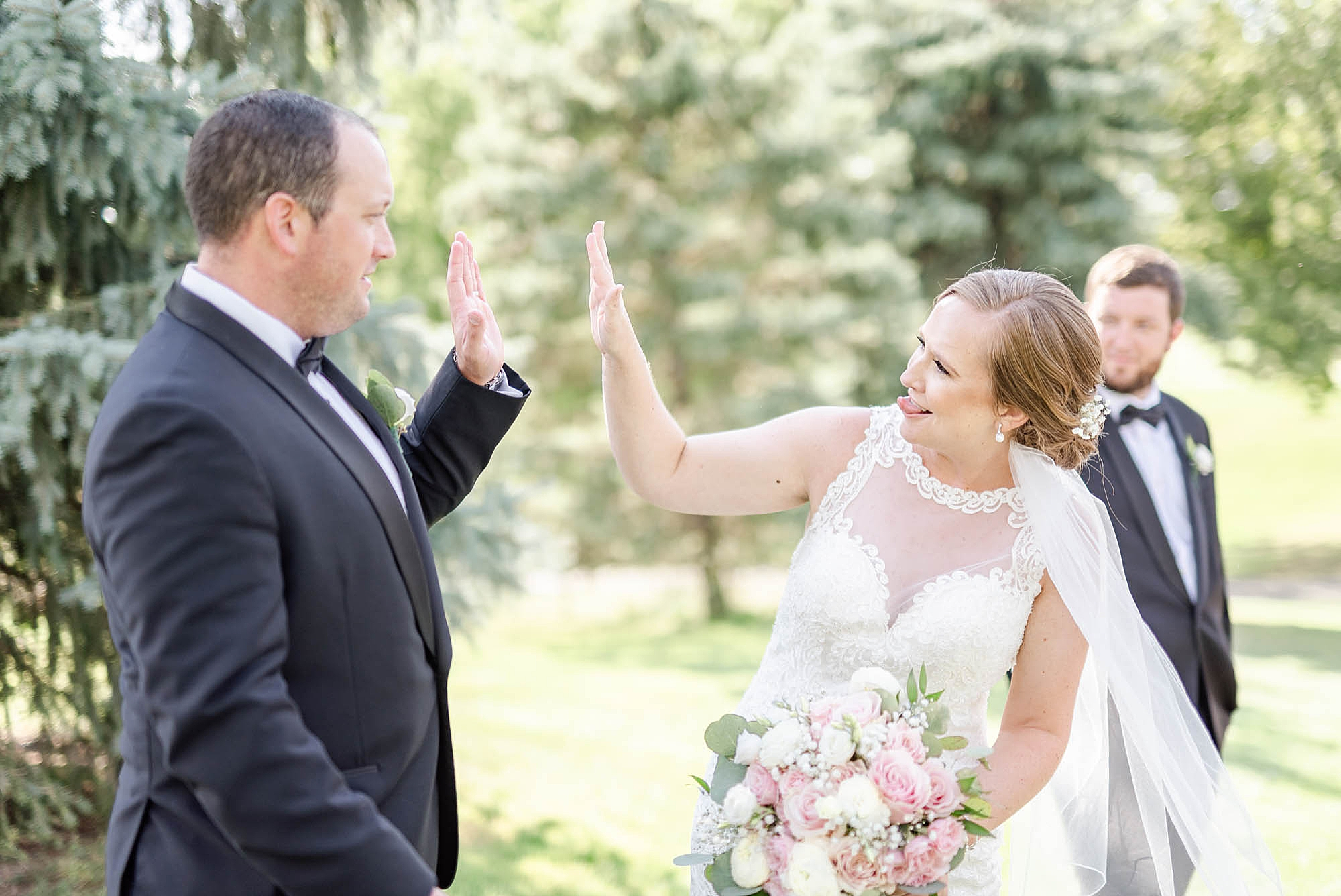 bride and groom high five after wedding ceremony