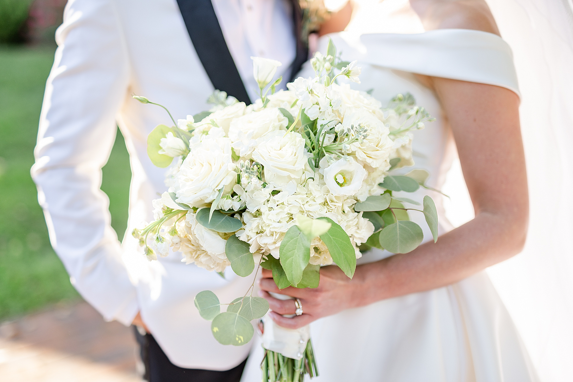 bride holds all-white bouquet during Ohio wedding portraits