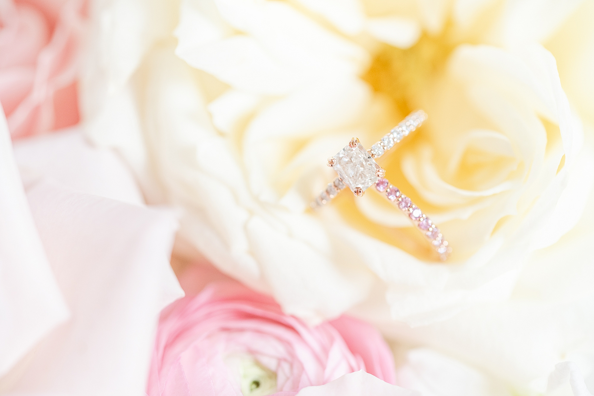 wedding ring sits on yellow flower in Ohio