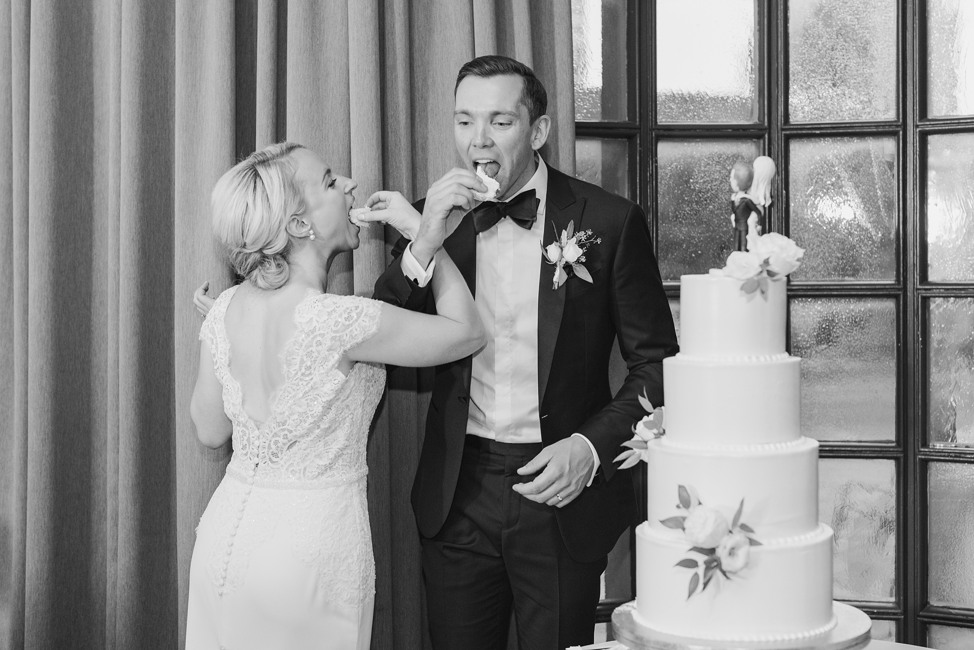 bride and groom eat wedding cake during Columbus OH wedding reception